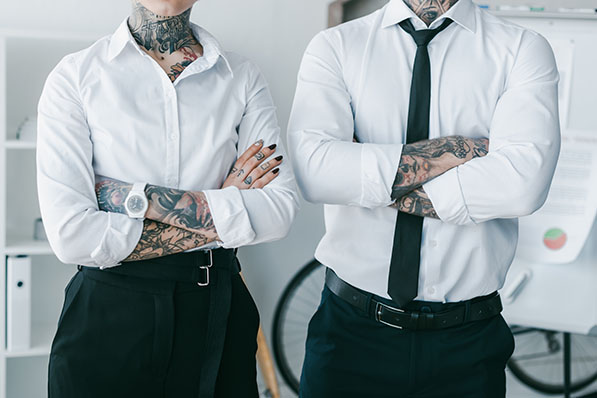 Visible tattoos and non-traditional hair color are now acceptable in more workplaces.